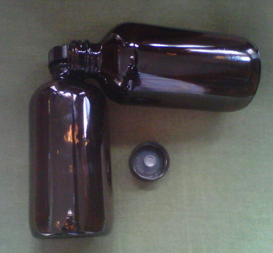 Primary image for Amber glass round bottle with black cap & dropper - 8 oz.