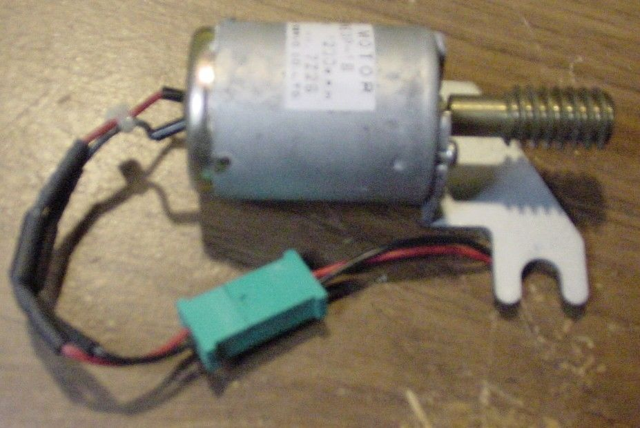 "Primary image for Small 24 V DC Motor with 3/8"" spiral Approx 10 threads/inch drive shaft. 1-1/4"""