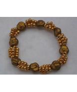 Czech Flower & Seed Gold Color Stretch Bracelet - $3.00