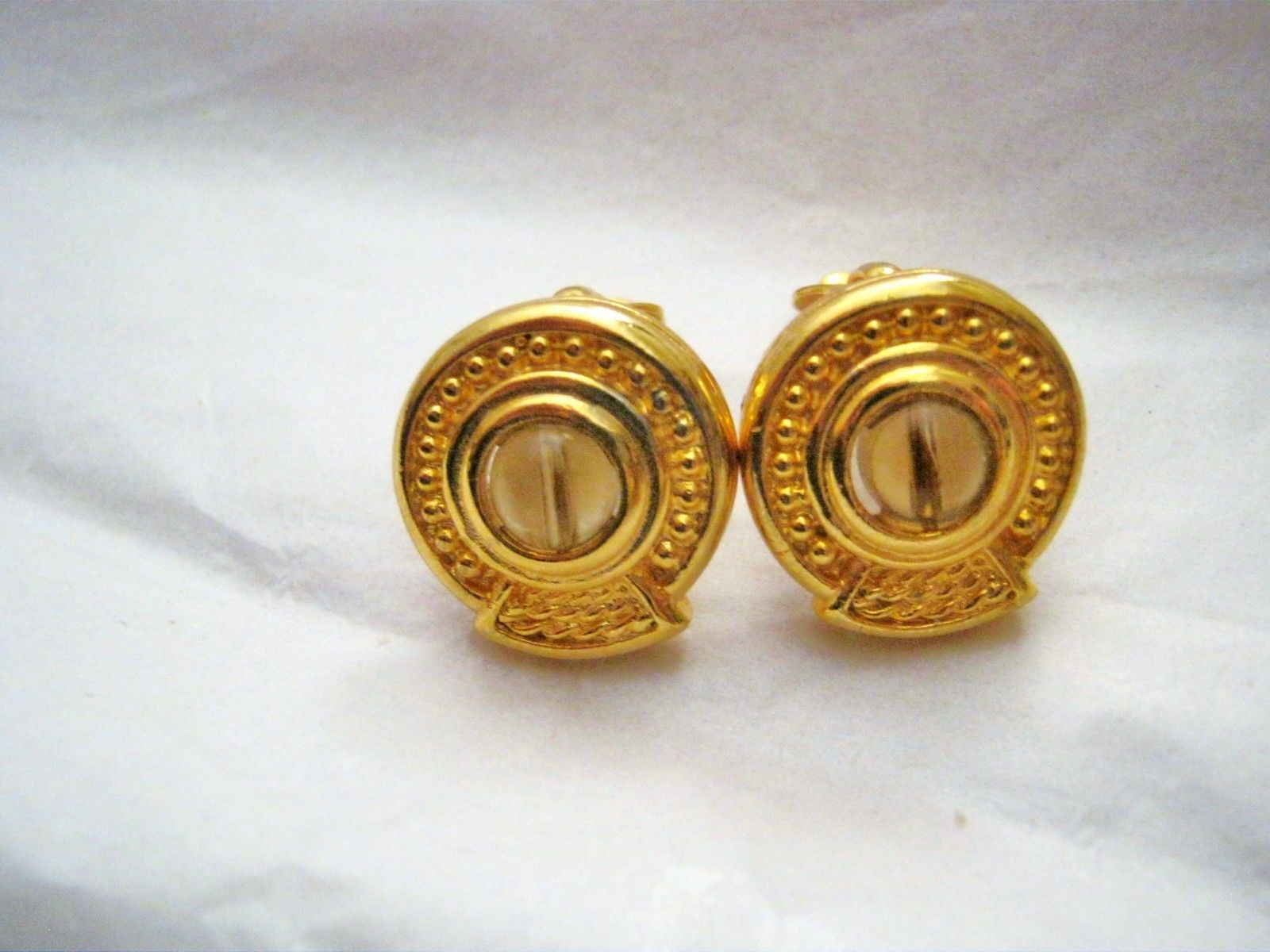 Primary image for Vintage Tiki gold tone brown bead round clip earrings signed 3/4""