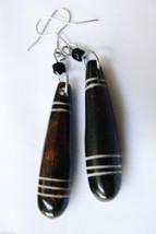 Carved stone dangling drop earrings - $28.00