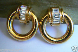 Gold Tone Metal Dangle Ring Crystal Clip Earrings - $19.96