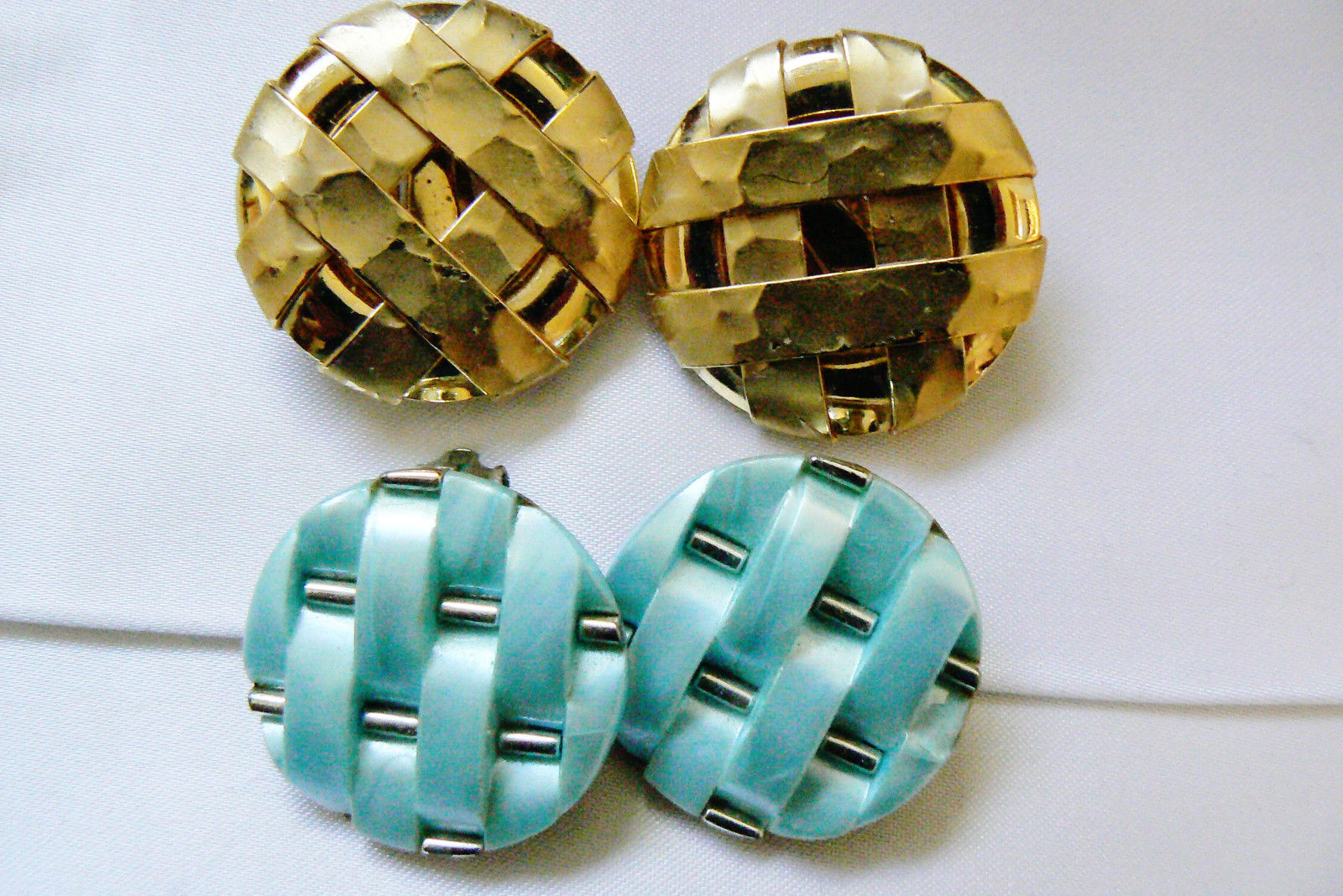 Primary image for Lot of 2 VTG large weaved round blue thermoset & gold tone clip earrings