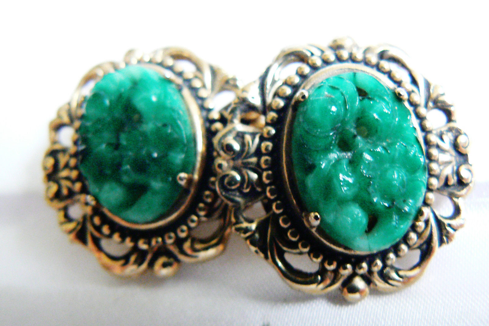 Primary image for ELEGANT GOLD TONE GREEN GLASS CARVED FLORAL SWIRL CLIP EARRINGS