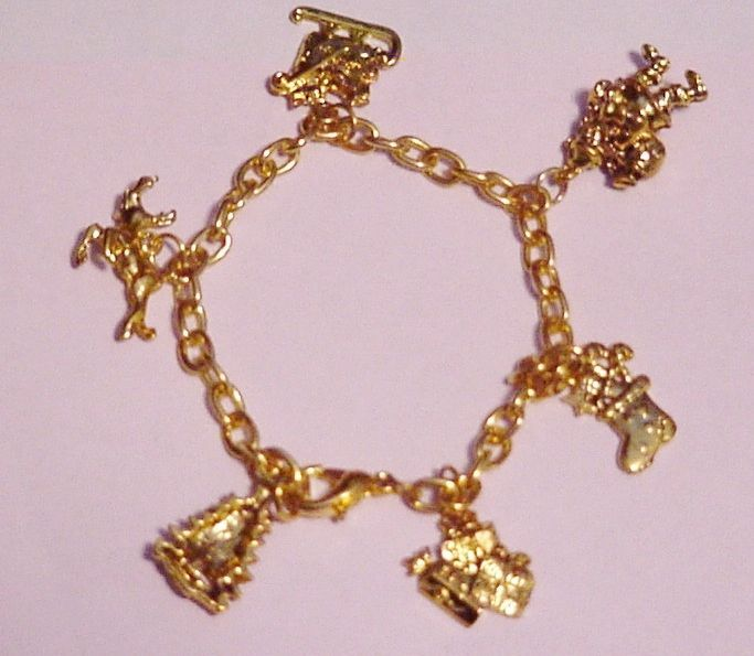 Primary image for CHRISTMAS GOLD-TONE 6 CHARM BRACELET SANTA REINDEER SLEIGH PACKAGE STOCKING TREE