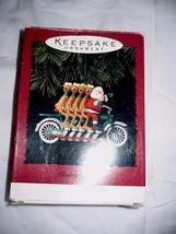 Hallmark Ornaments Cheery Cyclists 1994 Santa & His Reindeer  - $9.89