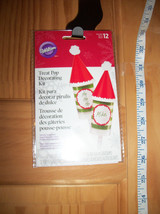 Wilton Party Supplies Set Santa Hat Christmas Holiday Treat Pop Decorating Kit - $9.49