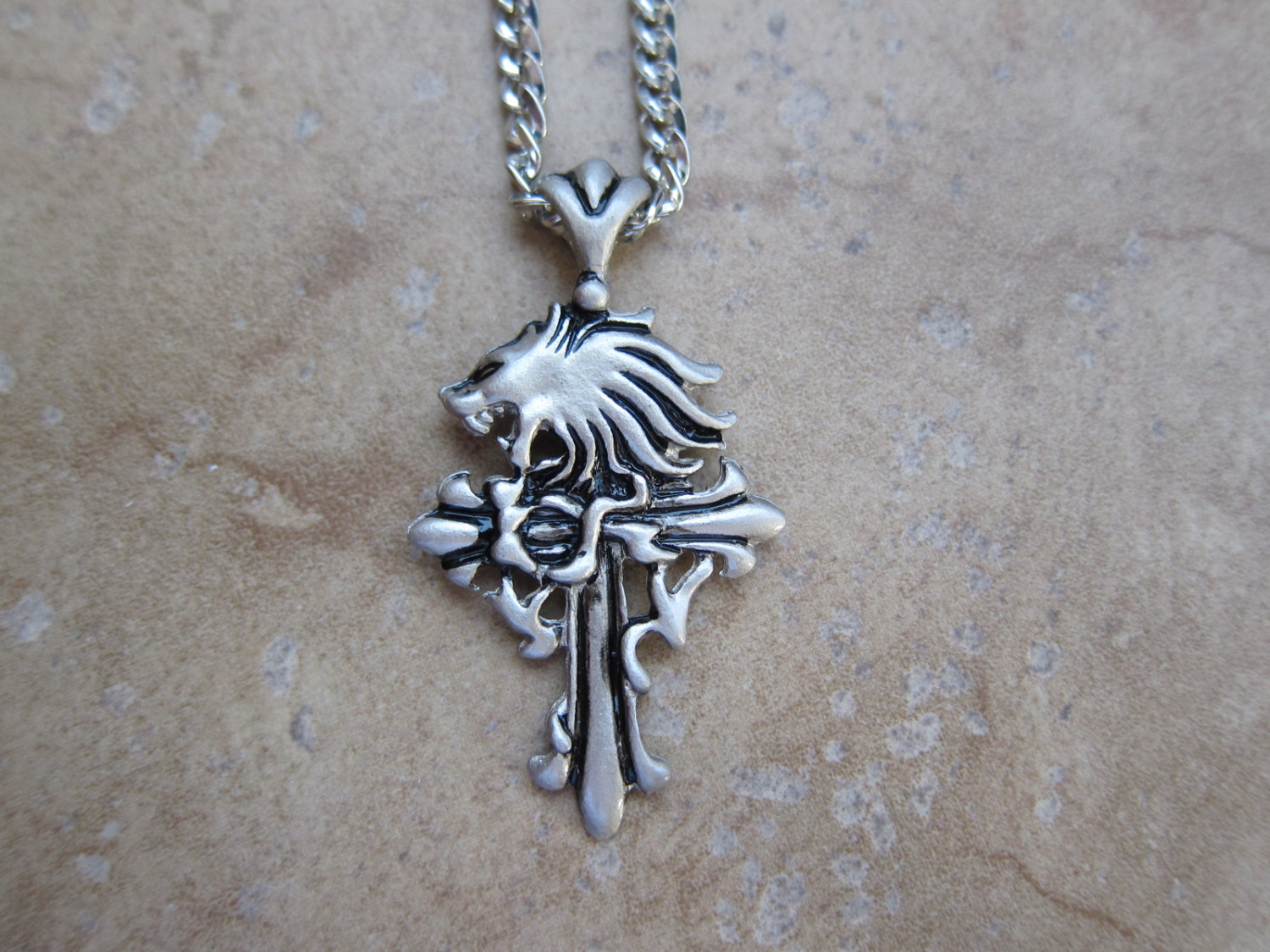 Final fantasy viii squall leonhart sleeping and 50 similar items final fantasy viii squall leonhart sleeping lion heart necklace mozeypictures Image collections
