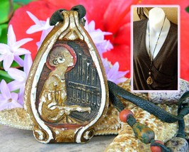 Vintage Saint Cecilia Pendant Necklace Carved Plaster Painted Cord  - $29.95