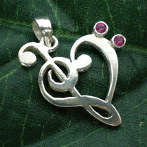 Treble & Bass Clef Heart Pendant - $30.00