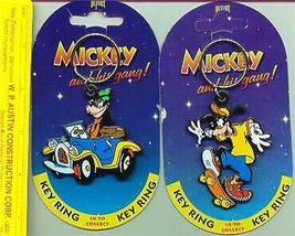 Disney Goofy Car Racing & Roller blading 2 Key Chains - $19.34