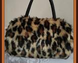 Ax19 324756 spotted leopard thumb155 crop
