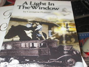 A LIGHT IN THE WINDOW SIGNED BY GEORGENE PEARSON