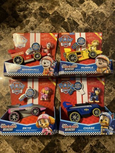 Primary image for Paw Patrol Ready Race Rescue Deluxe Race Go Rubble Chase Skye Marshall Lot of 4