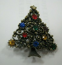 Christmas tree pin with lots of rhinestones marked JJ - $19.80