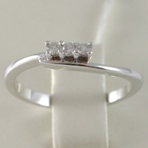 BAGUE EN OR BLANC 750 18K, TRILOGY, 3 DIAMANTS CARAT EN TOUT 0.08, AVEC LA VAGUE image 1