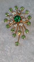 Star burst rhinestone pin brooch timeless swirl emerald green Vintage - $29.07 CAD