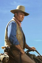 John Wayne in Chisum classic portrait on horse gunbelt in profile 18x24 Poster - $23.99