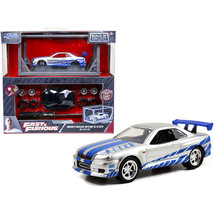 Model Kit Brian\'s Nissan Skyline GT-R R34 Silver and Blue Fast & Furious... - $24.22