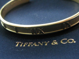 Tiffany & Co 18 Quilates Atlas Brazalete Oro Amarillo - $3,696.51