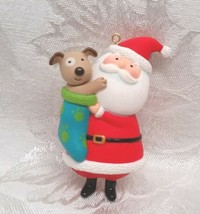 "Hallmark Christmas Ornament 2012 Santa Claus with Puppy in Stocking 3.5""  - $14.84"