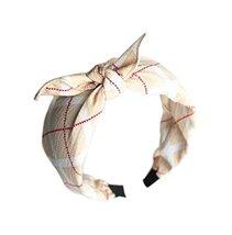 Beige Prints, Bow Headband and Broadside Designed