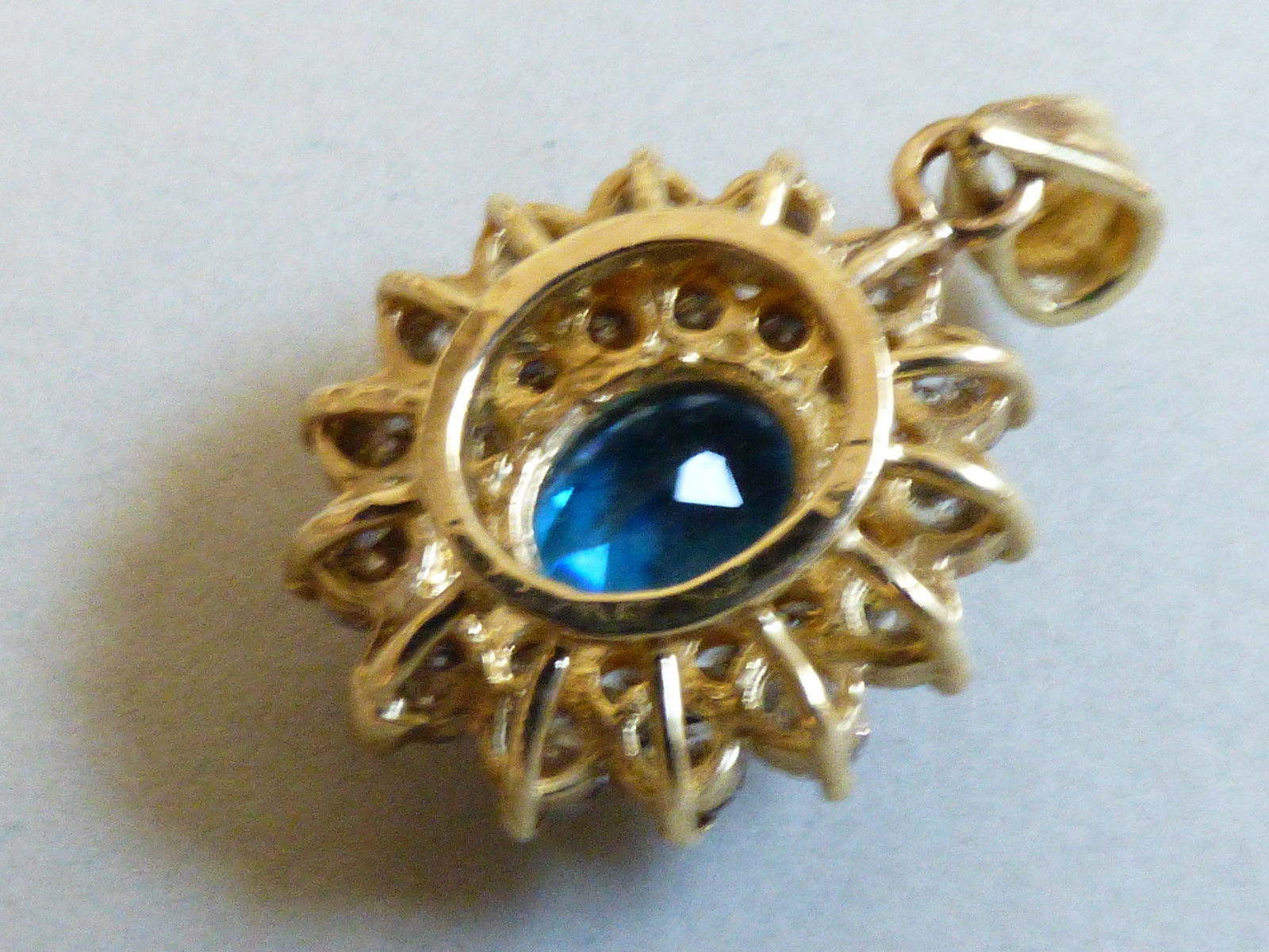 Classic 14kt Yellow Gold .68 CTTW Oval Blue Topaz & Round Diamonds Pendant