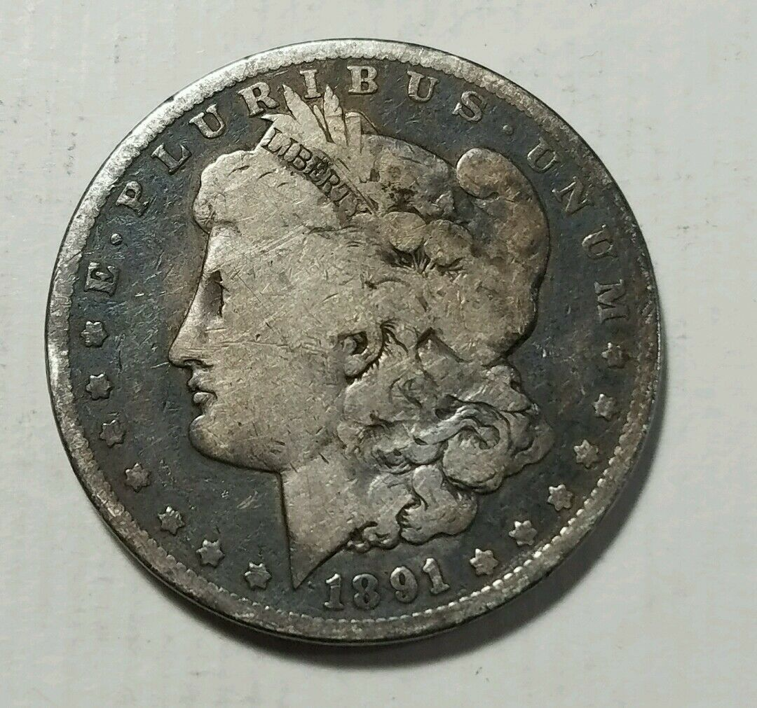 MORGAN SILVER DOLLARS . ONE  CULL COIN FULL DATE AND MINT MARK. 1878-1904.
