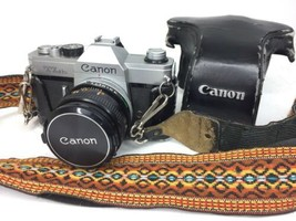 Canon TLB Camera with Carry Strap And Leather Case And Lense Fd 50mm 1:1.8 - $65.44