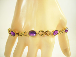 "AVON INFINITY OVAL AMETHYST PURPLE FACETED STONE GOLD PLATE BRACELET 8"" ... - $12.86"