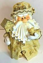 Santa Claus St. Nick Christmas resin figurine statue holding bird and bi... - $14.82