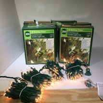 6 Boxes 200 Count 56' Green Wire Clear Light Set Holiday Time. New - $27.72