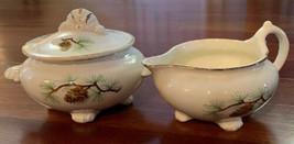 Homer Laughlin Nautilus Covered Sugar Bowl And Creamer Pine Cones Gold Trim - $32.66