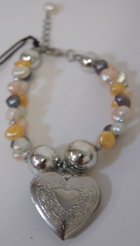 Coynes and Company Multi Color Pearl Like Bead Bracelet With Silver Color Locket