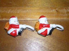 Vintage Pair of Ceramic Christmas Holiday Santa Claus w Backpack Candle ... - $7.69