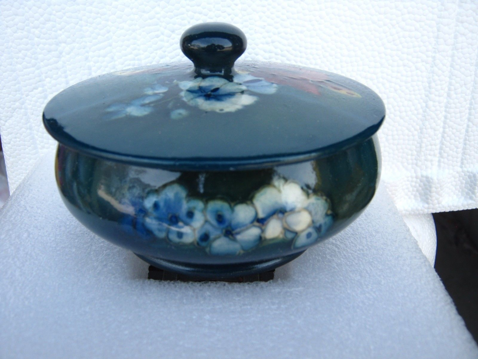 "Primary image for MOORCROFT ROUND covered box ""potter to the queen"" IN  dark blue WITH FLOWERS"