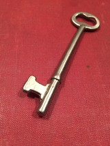 Vintage small silver skeleton Key with hourglass shaped top hole image 1