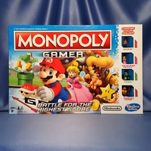 Monopoly Gamer with Two Bonus Set of Three Power Packs (6 Total) by Hasbro. - $65.00