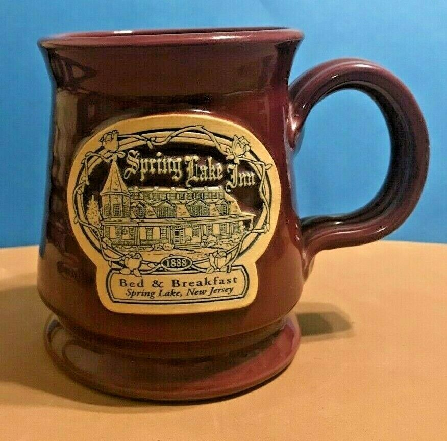 Primary image for DENEEN POTTERY BURGUNDY FOOTED MUG-  SPRING LAKE INN, SPRING LAKE, NEW JERSEY