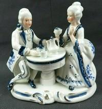 Vintage Porcelain Ceramic Figurine Man & Woman Tea Time Scene White & Blue - $25.00