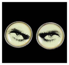 silver cufflinks with eyes on cream background, supplied in gift box very detail