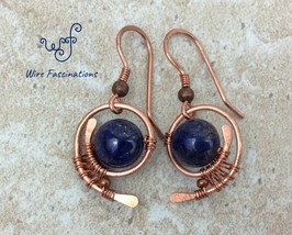 Handmade lapis lazuli earrings: copper wire wrapped swirl - $28.00