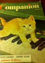 Window ad for 1941 Womans Home Companion with adotable kitten on piano - $26.85