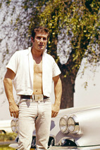 Robert Fuller in open shirt hunky pose by vintage car 18x24 Poster - $23.99