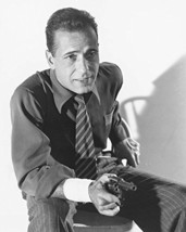 Humphrey Bogart In Shirt And Tie Smiling As He Pulls Gun 16X20 Canvas Giclee - $69.99