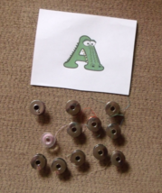 Lots of vintage bobbins, bobbin cases, and other sewing machine parts - $7.00+