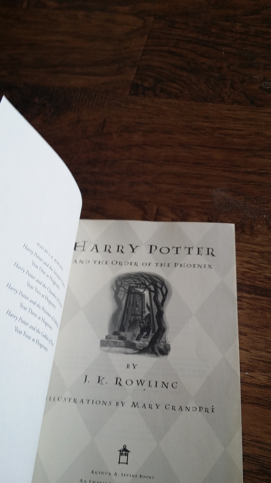Harry Potter and The Order of The Phoenix by J.K. Rowling (2003 Hardcover)