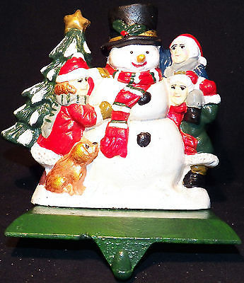 Primary image for Vintage Heavy Unmarked Cast Iron Snoman Christmas Stocking  Hanger Holder 2.5lbs