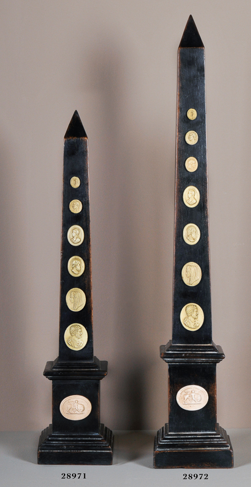 New set of Two Obelisk with Cameos,27'' and 33'' Tall.