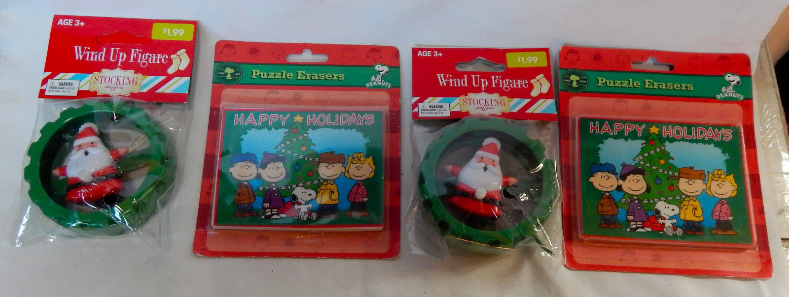 Christmas Holiday Peanuts Puzzle Erasers 2ea & Santa Wind Up Figures 2ea 3+ 27T